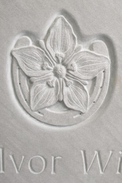 Carved rose and horseshoe